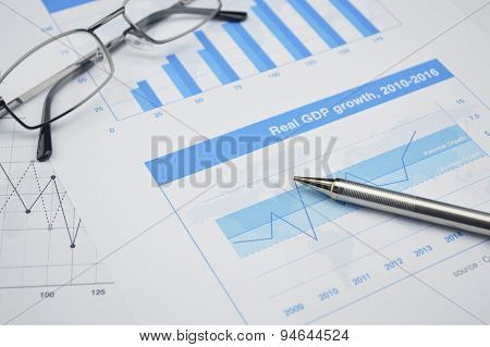 Pen And Glasses On Financial Chart And Graph, Accounting Background