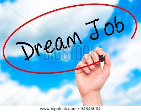 Man Hand writing Dream Job with black marker on visual screen.