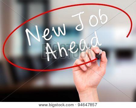 Man Hand writing New Job Ahead with black marker on visual screen.