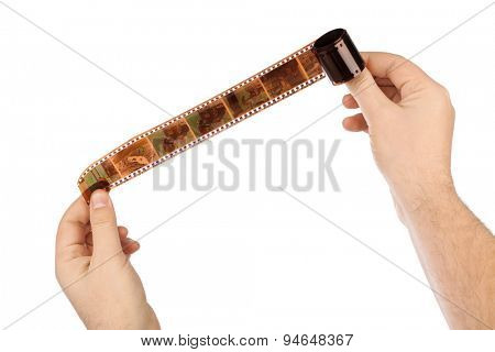 Photographic film (my photos) in hands isolated on white background