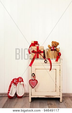 Vintage christmas background with presents and red and white decoration.