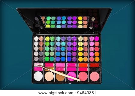 Palette Of Colorful Eye Shadows And Makeup Brush