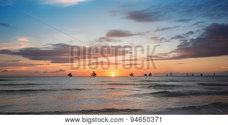 Sunset over sea, beach with colorful sky