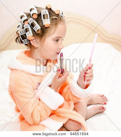 Little Girl With Lipstick And Mirror And Hair Curlers