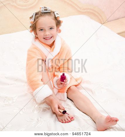Happy Funny Little Girl Polishing Her Nails