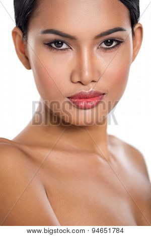 Beauty portrait, young Asian woman with heathy skin looking at camera