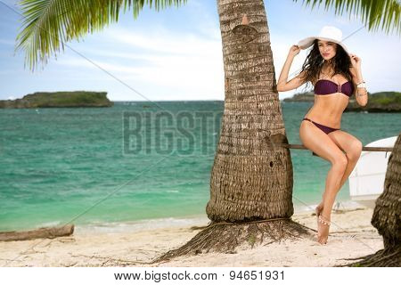 Young attractive woman enjoy at tropical resort