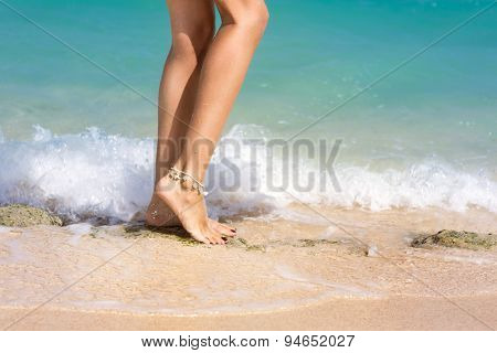 Sexy, fit female legs in in waves