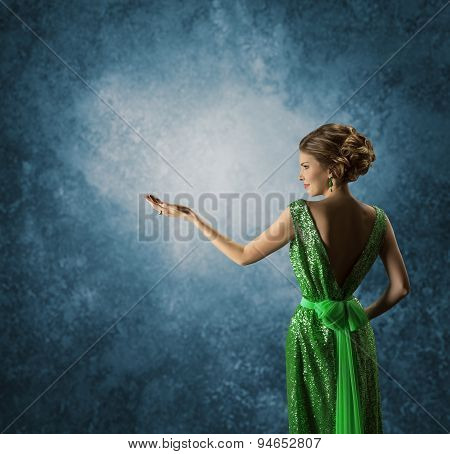 Woman Green Dress Showing Empty Hand, Elegant Model In Rich Gown