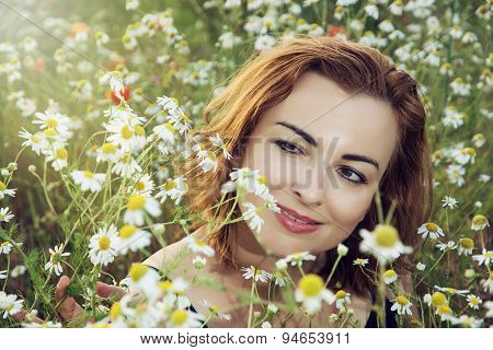 Young Caucasian Brunette Woman In Daisy Meadow