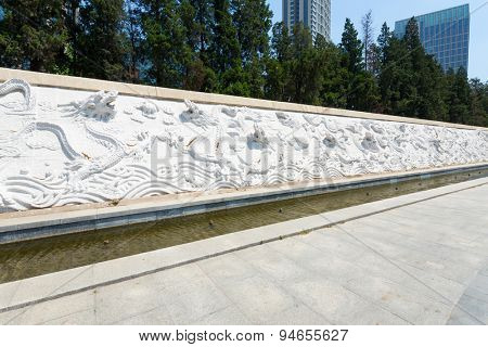 Tianjin,China-May 22,2015: Dragon sculpture wall in park of tianjin.