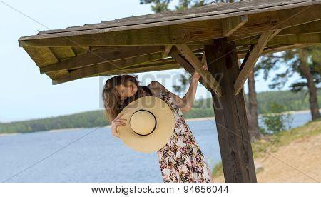 Beautiful Woman In Summer Dress And Hat Near The Lake