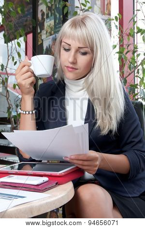 Woman With Business Papers And Cup Of Coffee