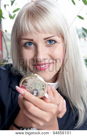 Young Attractive Woman With A Compact Mirror