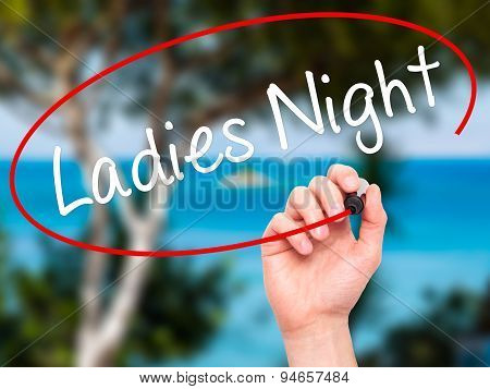 Man Hand writing Ladies Night with black marker on visual screen.