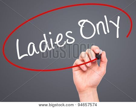 Man Hand writing Ladies Only with black marker on visual screen.
