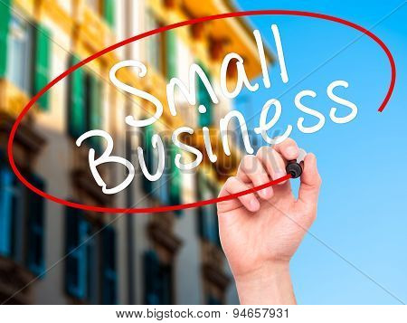Man Hand writing Small Business with black marker on visual screen.