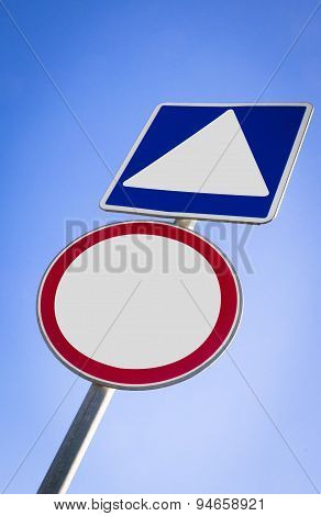 A blank road sign on a blue graduated sky.