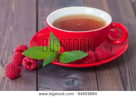 Cup Of Hot Black  Tea With Mint And Raspberry