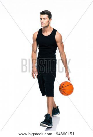 Portrait of a handsome man in sports wear playing in basketball isolated on a white background