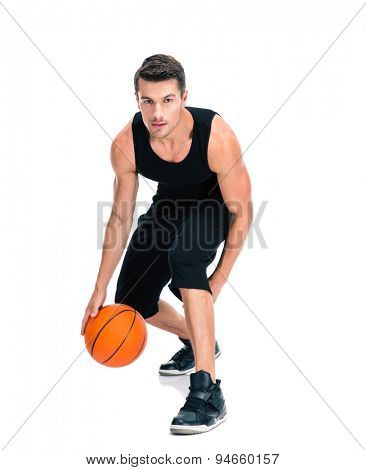 Full length portrait of a handsome man playing in basketball isolated on a white background