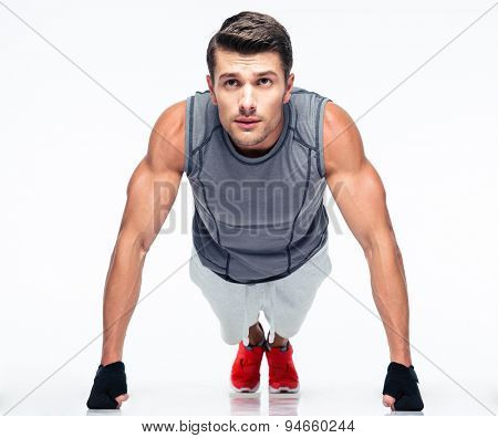Fitness young man doing push ups isolated on a white background