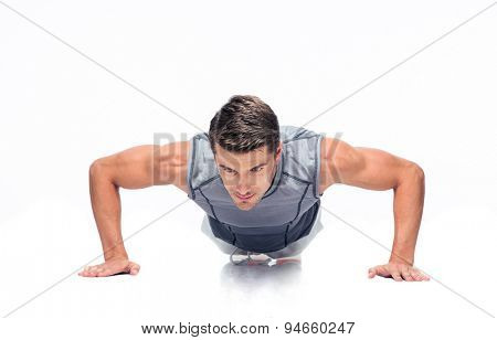 Fitness handsome man doing push ups isolated on a white background