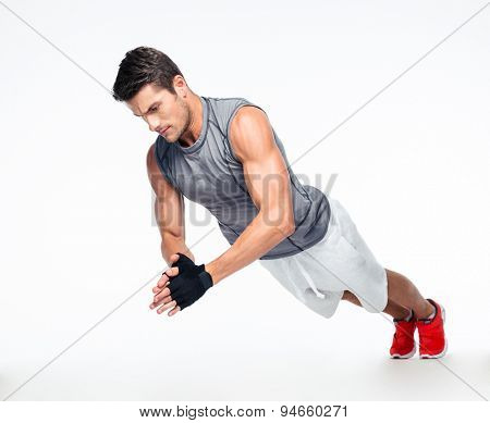 Fitness man doing exercises on the floor isolated on a white background