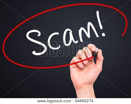 Man Hand writing Scam! with black marker on visual screen.