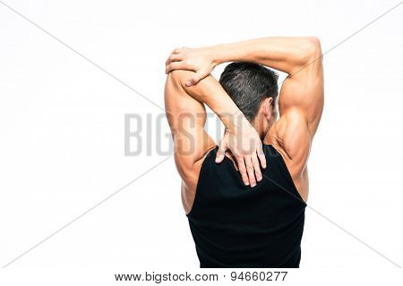Back view portrait of a muscular man stretching hands isolated on a white background