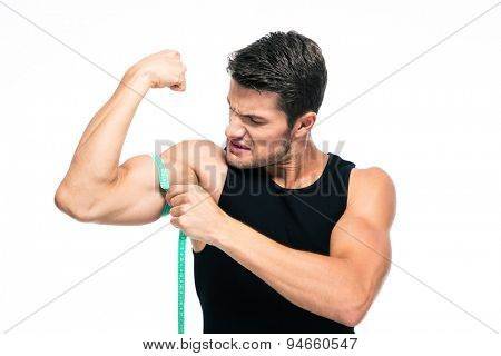 Sports man measuring his biceps isolated on a white background