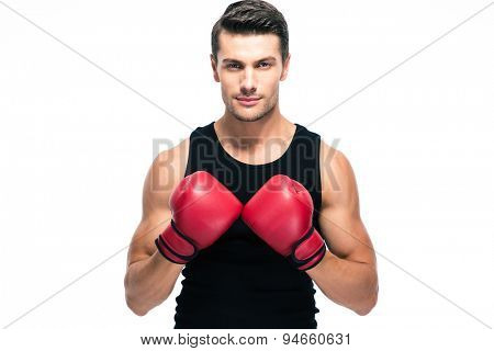 Handsome man standing with boxing gloves isolated on a white background. Looking at camera