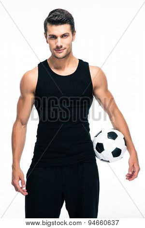 Handsome soccer player holding ball isolated on a white background. Looking at camera