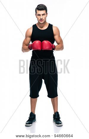 Full length portrait of a sports man with red boxing gloves isolated on a white background