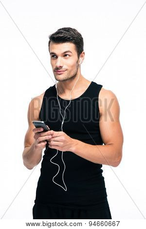 Fitness man using smartphone with headphones isolated on a white background. Looking up