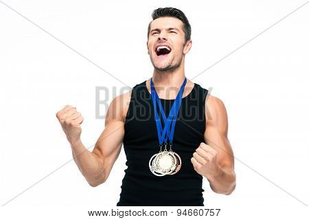 Fitness young man with medals celebrating his success isolated on a white background