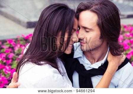 Portrait of a happy romantic couple hugging