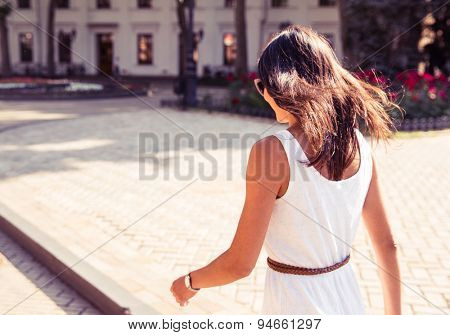 Stylish woman walking outdoors in summer
