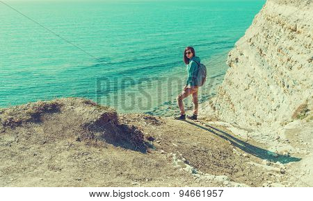 Traveler Girl Walking Near The Sea In Summer