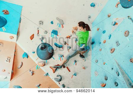 Woman Exercising In Climbing Gym