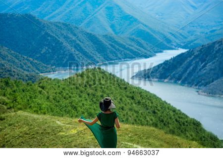 Woman walking on the mountains