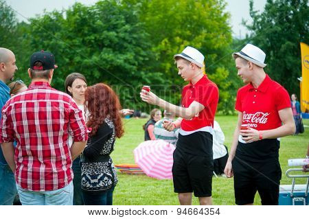 MOSCOW - JUNE 20, 2015: Promoters handing out free cans of Coca-Cola Zero on XII International Jazz Festival