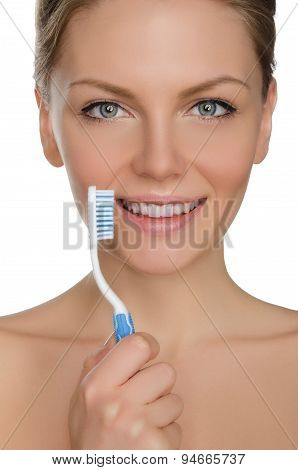 Beautiful Woman With Toothbrush In Mouth