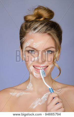 Smiling Woman With Toothbrush And Toothpaste