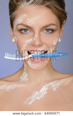 Woman With Toothbrush Mouth And In Toothpaste