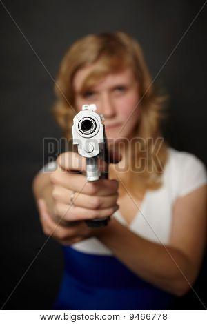 Woman Aiming A Gun