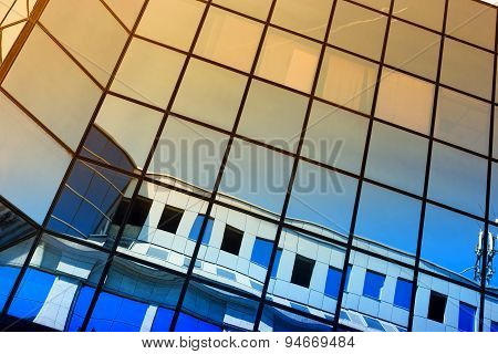 Windows Of Office Building And Sky Reflection