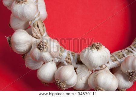 Close Up Of Garlic On A Red Background