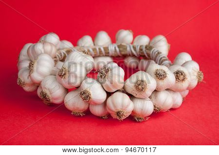 Garlic On A Bright Red Background