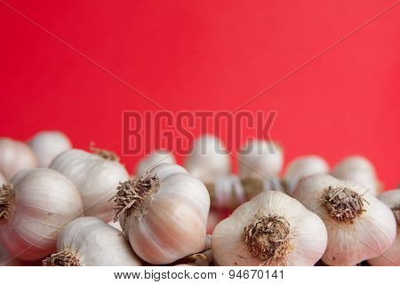 Red Background With Garlic In The Bottom